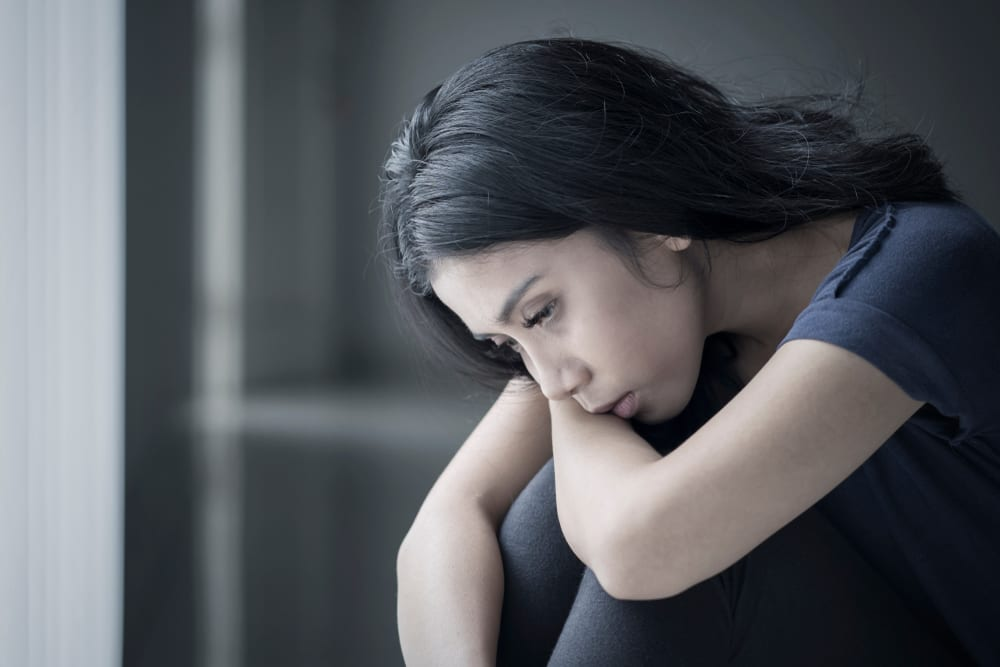 Sad woman suffering from anorexia and needs some mental health support